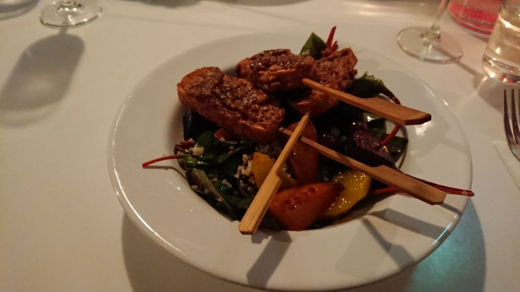 Tempeh Satay Skewers on roasted beet and citrus salad with quinoa trio